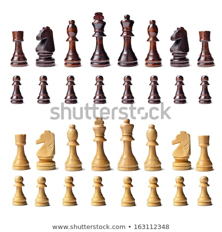 Wooden Chess Pieces on a Wooden Chessboard Stock photo © Frankljr