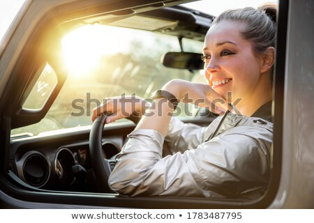 attractive blond lady with a golden cross stock photo © nejron