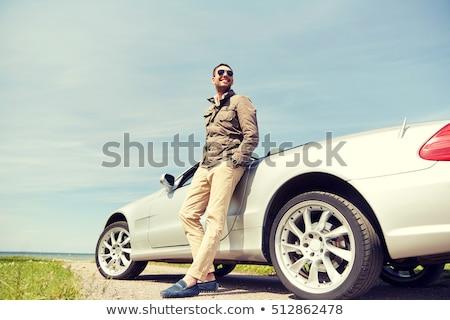 человека · расслабляющая · гамак · говорить · мобильного · телефона · пляж - Сток-фото © nejron