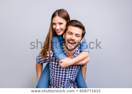 man embracing his girlfriend from the back stock photo © feedough