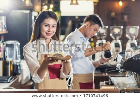 Female Bartender Serving Drink To Customer Stock photo © HighwayStarz