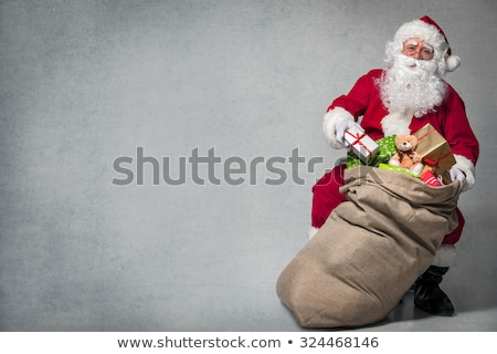 Santa Claus gift bag full of toys and gifts Stock photo © HASLOO