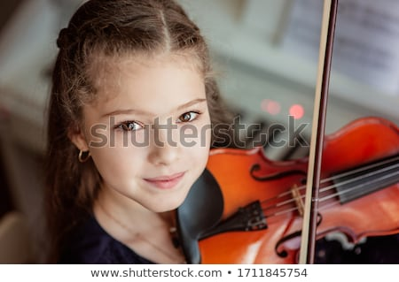 young girl learning to play violin stock photo © highwaystarz
