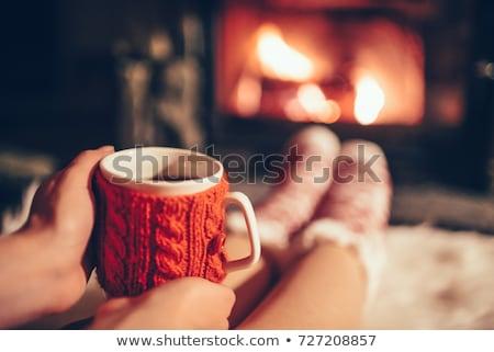 femenino · manos · guantes · taza · café - foto stock © hasloo