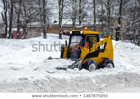 Tractor Cleaning Road from Snow in the Heawy Snowfall stock photo © maxpro