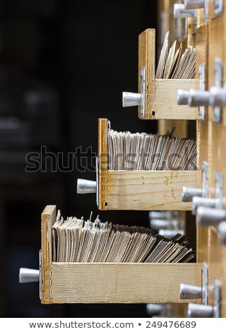 Three open drawers in the archive library on a dark background Stock photo © Valeriy