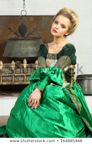 Stock photo: Beautiful young woman in green corset
