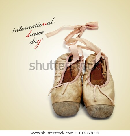 Stock photo: pointe shoes and the text dance day, with a retro effect
