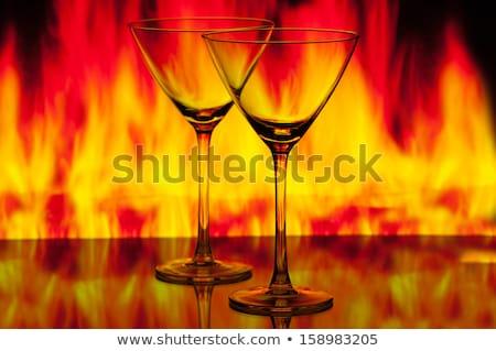 マティーニグラス 火災 暗い 水 背景 夏 ストックフォト © OleksandrO