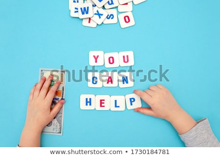 Charity - Word on Blue Puzzles. Stock photo © tashatuvango