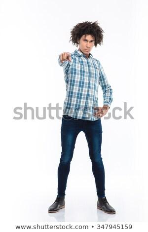 africano · americano · homem · cabelos · cacheados · indicação · dedo - foto stock © deandrobot