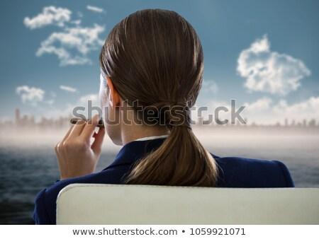 woman smoking cigar stock photo © rastudio