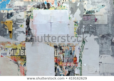 urban grunge texture torn posters and graffiti on street wall stock photo © stevanovicigor