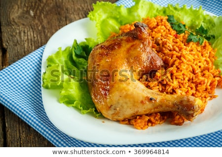 Delicious dish of chicken thigh with rice and salad leaves Stock photo © vlad_star