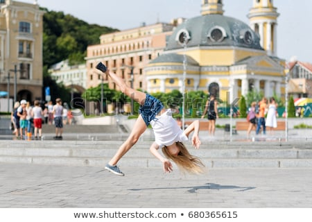 Beautiful girl engaged in artistic gymnastics Stock photo © krugloff