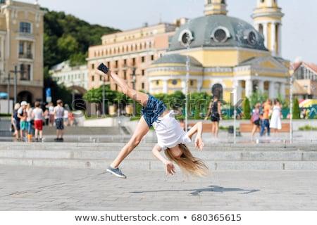 beautiful girl engaged in artistic gymnastics stock photo © krugloff