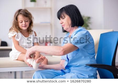 Little girl with broken leg Stock photo © bluering