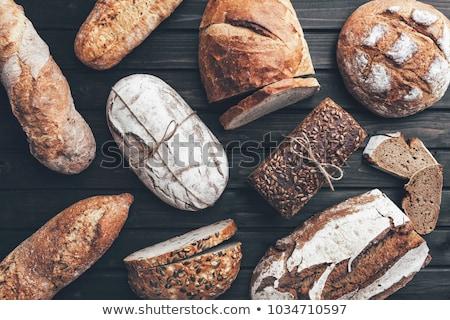 Delicious freshly baked bread on wooden background stock photo © janssenkruseproducti