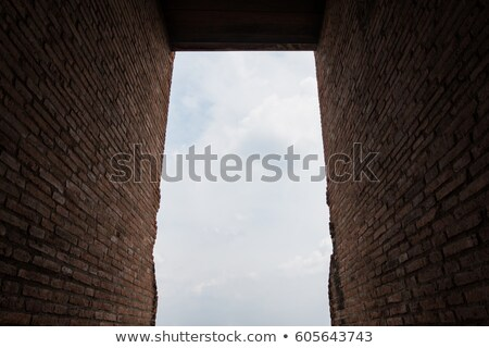 brick wall tunnel and cloud sky background walk way to sunlight stock photo © frameangel