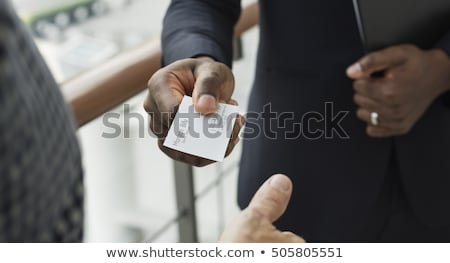 Stock photo: businessman handing a business card