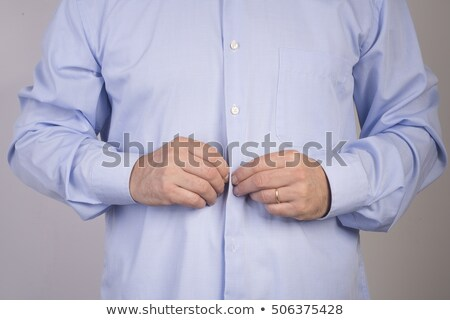 businessman buttons up his jacket stock photo © gsermek