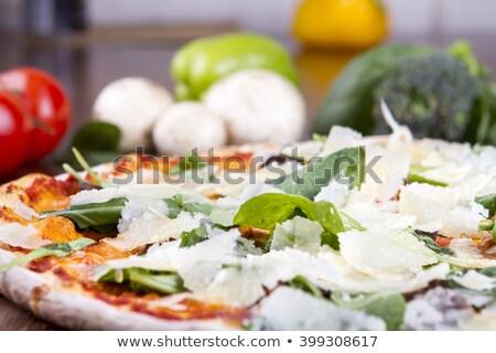 Parmesan cheese on wooden spatula Stock photo © Digifoodstock