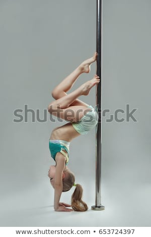 woman exercise pole dance on gray background Stock photo © chesterf
