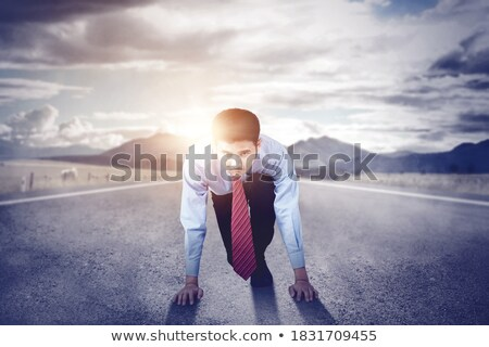 Businessman gesturing while kneeling Stock photo © wavebreak_media
