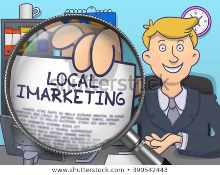 local imarketing concept through magnifier stock photo © tashatuvango