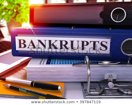 bankrupts on blue office folder toned image stock photo © tashatuvango