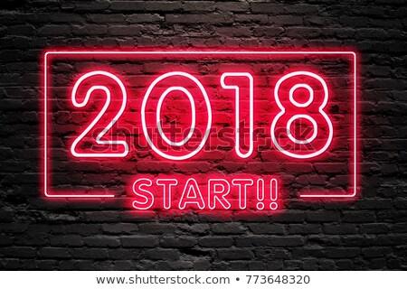 start now on dark brick wall stock photo © tashatuvango