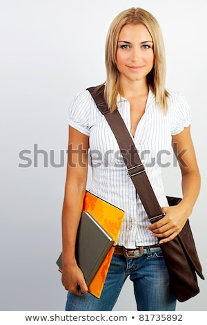 happy students standing and smiling with books laptop and bags stock photo © vlad_star