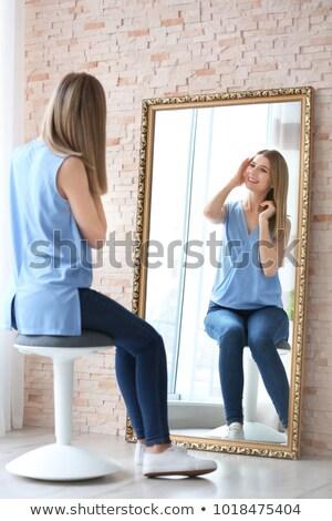 attractive woman sitting on stool stock photo © filipw