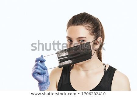 Retrato feminino cirurgião máscara cirúrgica olhando Foto stock © stevanovicigor