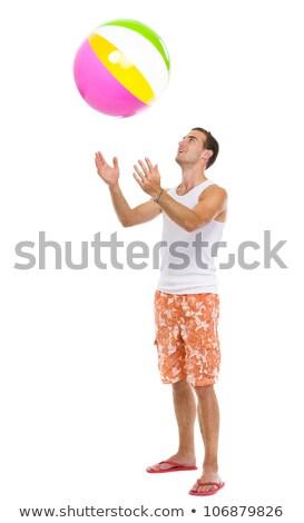 Jeune homme up ballon de plage homme nature Photo stock © IS2
