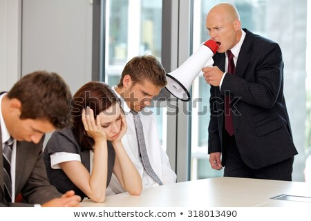 Woman shouting at man with mega phone Stock photo © IS2