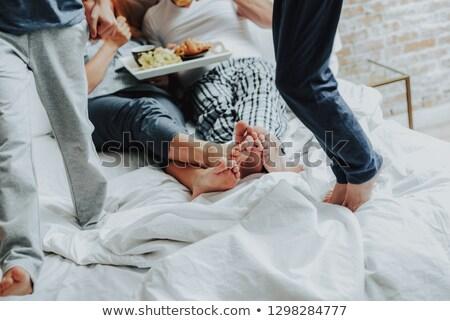 молодым · человеком · завтрак · кровать · комнату · отель · чай - Сток-фото © is2