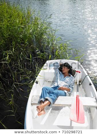 Kobieta drzemka łódź wiosłowa podróży jezioro Zdjęcia stock © IS2