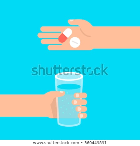 Doctor holding a glass of water and a pill Stock photo © CsDeli