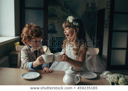 Girls having a tea party Stock photo © IS2