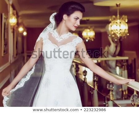 Attractive married couple on their honeymoon in luxurious hotel Stock photo © konradbak