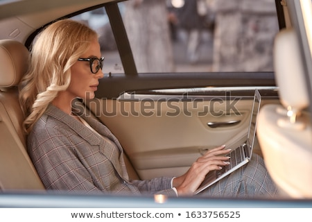 Business woman with laptop in taxi Stock photo © IS2