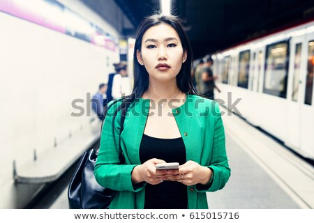 asian woman with long dark hair looking at camera with beautiful stock photo © deandrobot