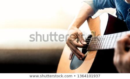 közelkép · gitáros · játszik · akusztikus · gitár · kéz · férfi - stock fotó © dolgachov