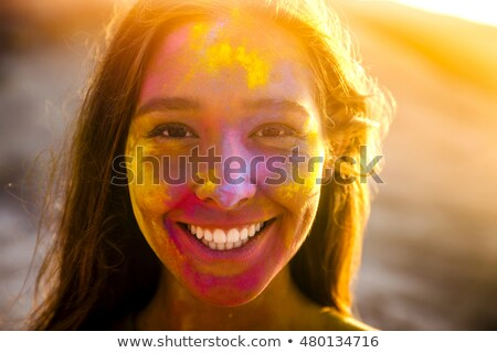 Woman paints the face of a girl Stock photo © acidgrey