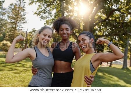 felice · donna · bicipiti · fitness - foto d'archivio © deandrobot
