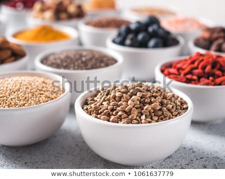 Various superfoods in small bowl on blue background stock photo © Illia