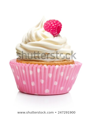 Cupcake with pink cream and red berry stock photo © TasiPas