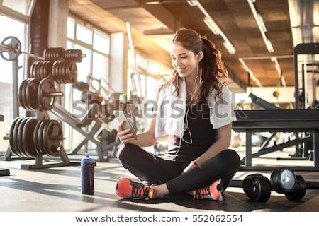 Fiatal fitt sportos nő pihen hallgat Stock fotó © boggy