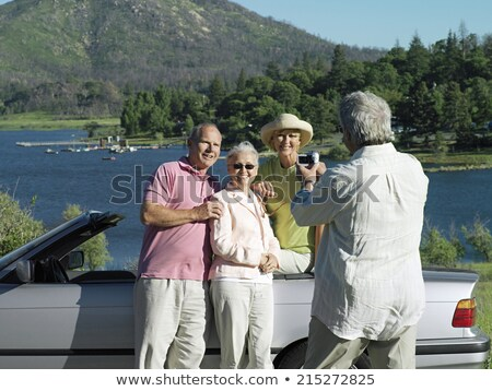 friends photographing in convertible car Stock photo © dolgachov